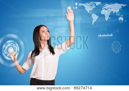 Young woman pressing button and looking up at left hand
