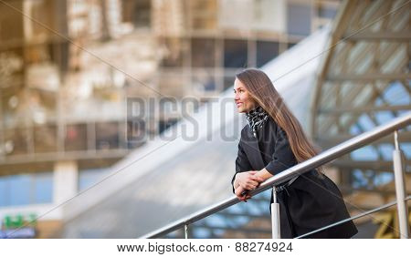 business woman standing in the big city