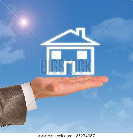 House model in right hand of real estate agent