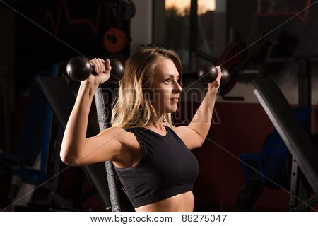athletic girl to doing exercises on a sports apparatus