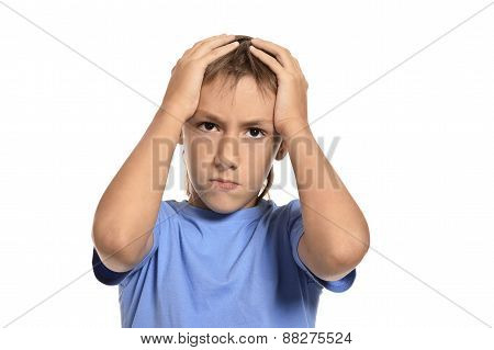boy shouting and holding his head