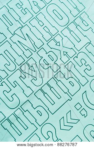 cyan cyrillic alphabet letters printed on white paper