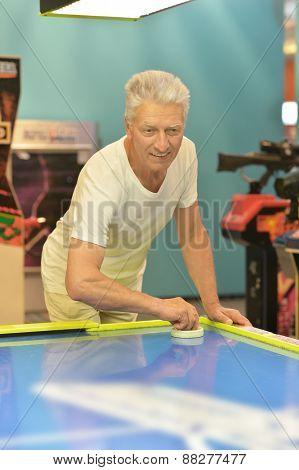 elderly man playing a board game