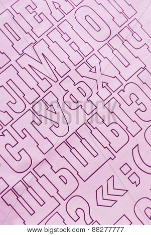 pink cyrillic alphabet letters printed on white paper