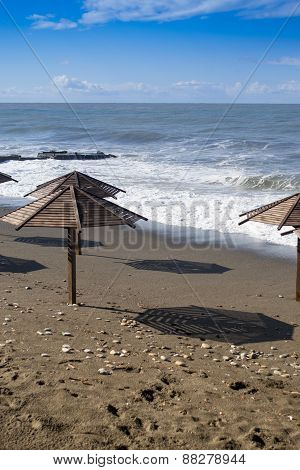 Waves And Sun Parasols