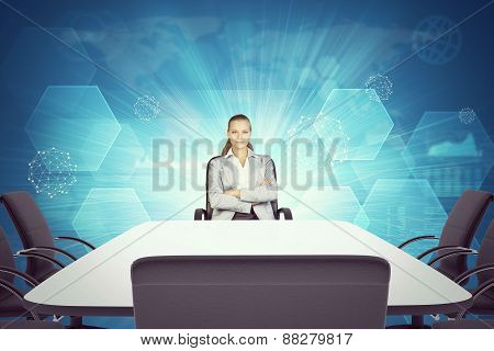 Smiling Business lady sitting  at table