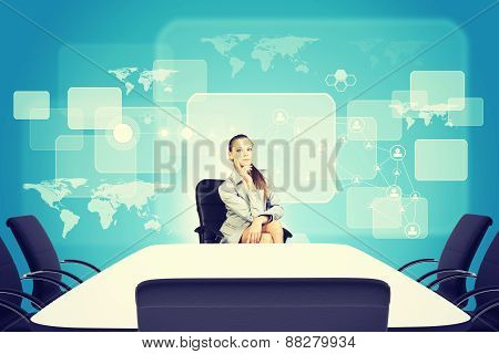 Business lady sitting at the table with thoughtful face
