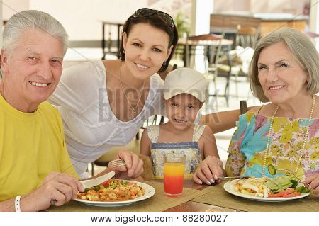 Grandparents with grandchild at breakfast