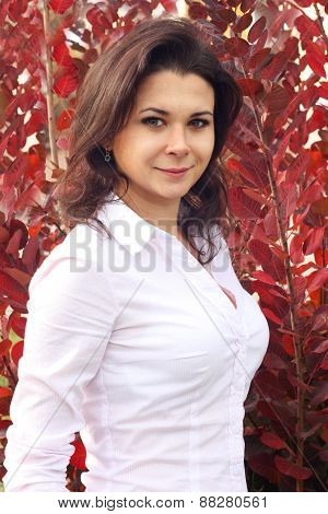 Portrait Of Woman On Red Autumn Background