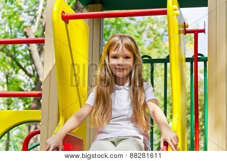 Active Girl On Nursery Platform In Summer
