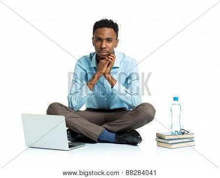 African American College Student With Laptop, Books And Bottle Of Water Sitting On White