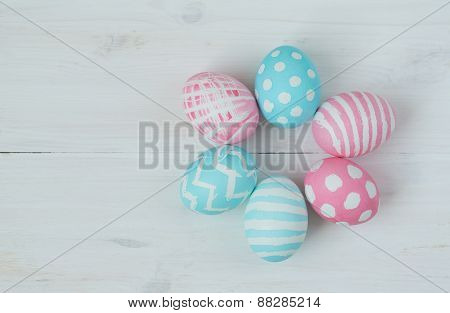 Pink And Blue Eggs On A Wooden Background
