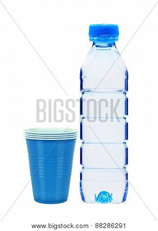 Blue Bottle With Water And Plastic Cups Isolated On White