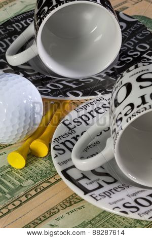 Two Empty Coffee Cups And Golf Equipments