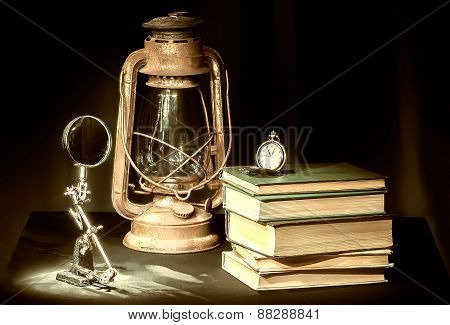 Still-life with books and kerosene lamp