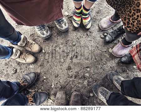 Feet Of People Standing In A Circle