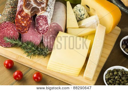 Lunch meats and cheese assortment on table