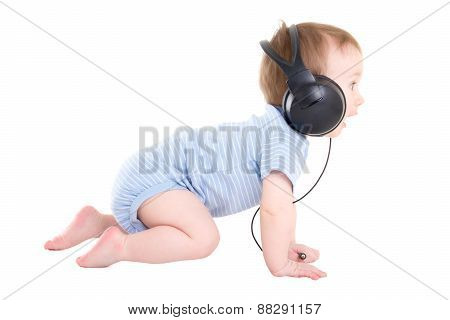 Side View Of Baby Boy Toddler With Headphones Isolated On White