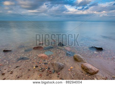 Rocky Shore Of Sea. Long Exposure Seascape.