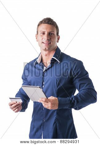 Young Businessman Holding a Credit Card and Tablet Computer