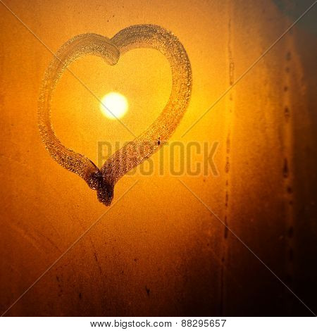 Heart On Window With Sun During Sunrise