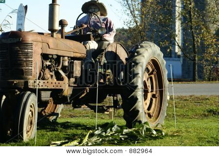 Old Tractor And Farmer