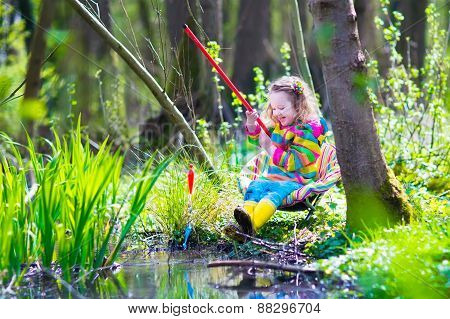 Little Girl Playing Outdoors Fishing