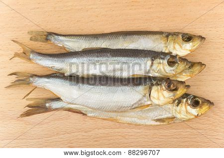 Some Smoked Fish On Wooden Board