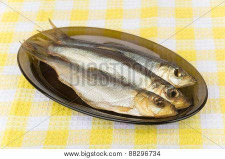 Smoked Herring In Black Glass Dish On Table