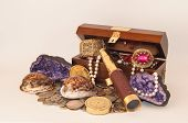 image of treasure  - treasure chest with variety of jewelry on white background - JPG