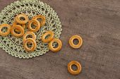 pic of doilies  - traditional bagels and lace doily on a wooden table - JPG