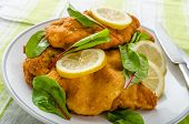 picture of veal  - Fried veal fillet with arugula lemon and spinach - JPG