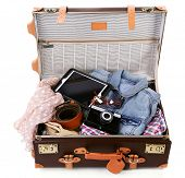 image of packing  - Packing suitcase for trip isolated on white - JPG