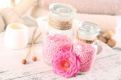 picture of sea salt  - Glass bottles with color spa sea salt on wooden table - JPG