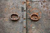 stock photo of door-handle  - Old vintage metal door with ring handles and keyholes - JPG