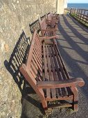 stock photo of pews  - Row of benches pathway seascape photographed at Sidmouth in Devon - JPG