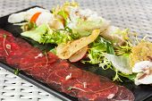 stock photo of rocket salad  - Beef carpaccio with parmesan cheese - JPG