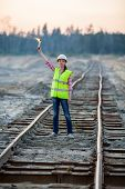 foto of torches  - female worker lights signal torch on rails - JPG