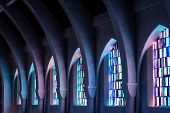 stock photo of chapels  - Arched columns in monastery chapel with stained glass windows - JPG