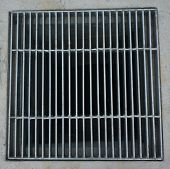 picture of grating  - Sewer grate made of steel rectangular shaped on the roadside - JPG