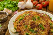 foto of cumin  - Fried potato pancakes with garlic and marjoram sprinkled cumin chive and coarse - JPG