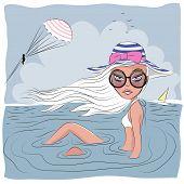 stock photo of beach shell art  - Girl on the beach lying in water - JPG