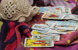 stock photo of wicca  - Classic Tarot cards on a desk for telling the future - JPG