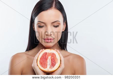 Pretty young healthy woman has perfect skin