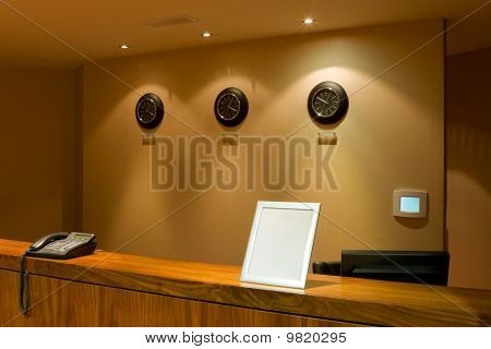 Reception Desk With Phone And Row Of Clock