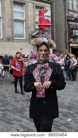 EDINBURGH - AUGUST 8: Member of Paperfinch Theatre publicize their show The Unbirthday Party during Edinburgh Fringe Festival on August 8, 2015 in Edinburgh, Scotland