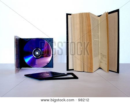 Picture or Photo of A CD, a book and a floppy disk are the modes for stock information.