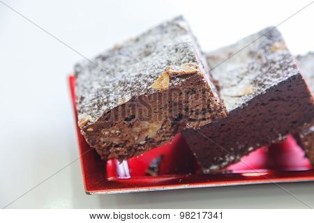 Several Chocolate Cakes Lies On A Plate
