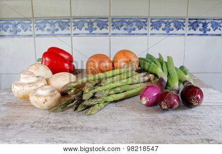 Vegetables In Front Of Tile