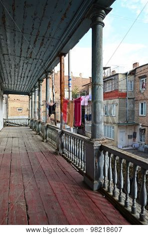 Old wooden balcony with laundry on the clothesline. Tbilisi, Georgia
